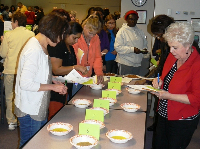 Fairfax administrators participate in spice tasting contest during workshop aimed at reducing sodium intake by increasing awareness of healthier seasoning alternatives.