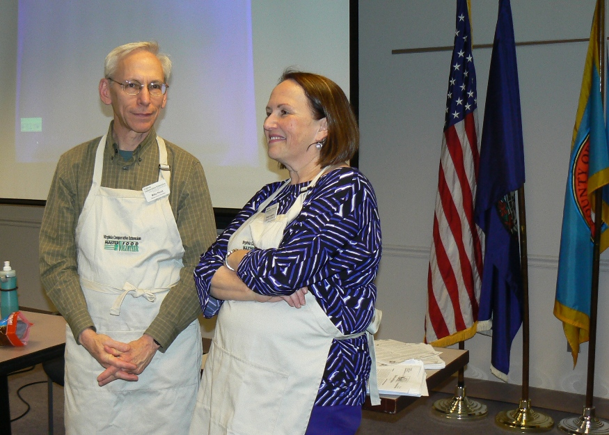 Master Food Volunteers Sue Lagon and Mike Perel discuss the outcome of the spice tasting contest. To their surprise, none of the participants were able to identify all six of the spices – basil, cumin, dill, oregano, sage and thyme.