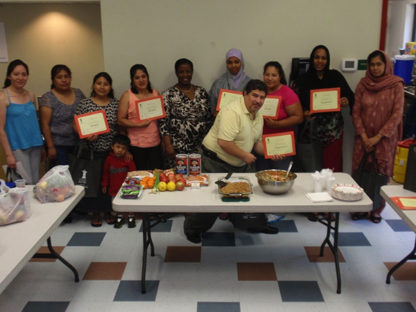 Participants receive certificates and Cooking Matters shopping bags at the final class on May 22.