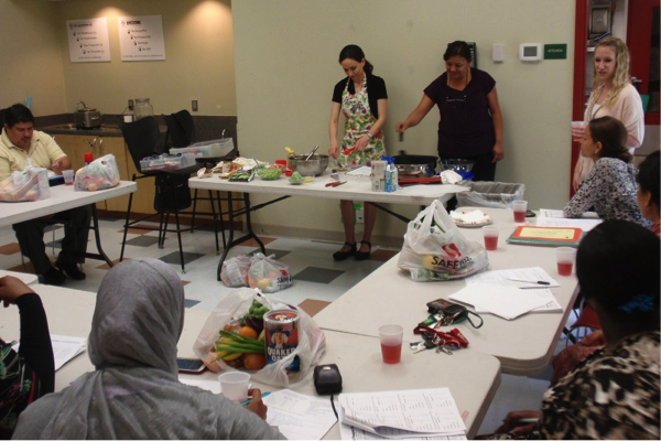 Instructors Katie Strong, Patricia Reyes, Jessica Forsty and Yara Saad discuss nutrition while demonstrating food preparation.