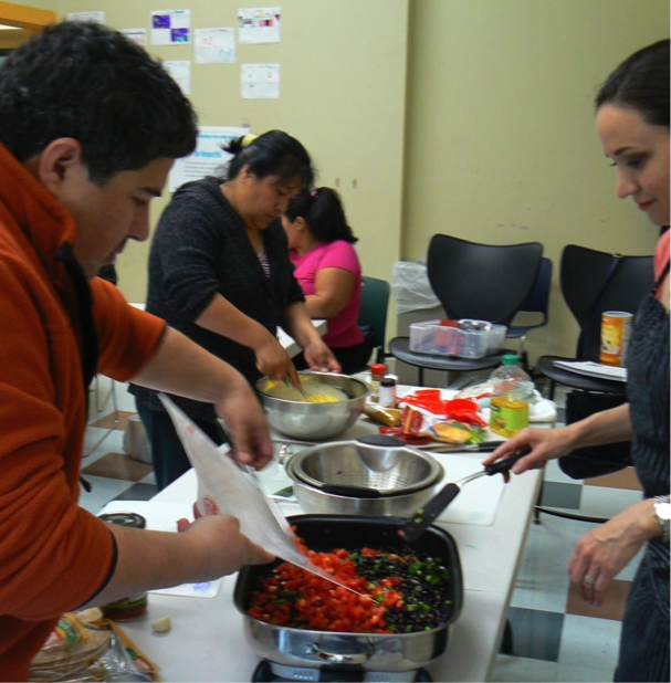 Participants help prepare hearty egg burritos.