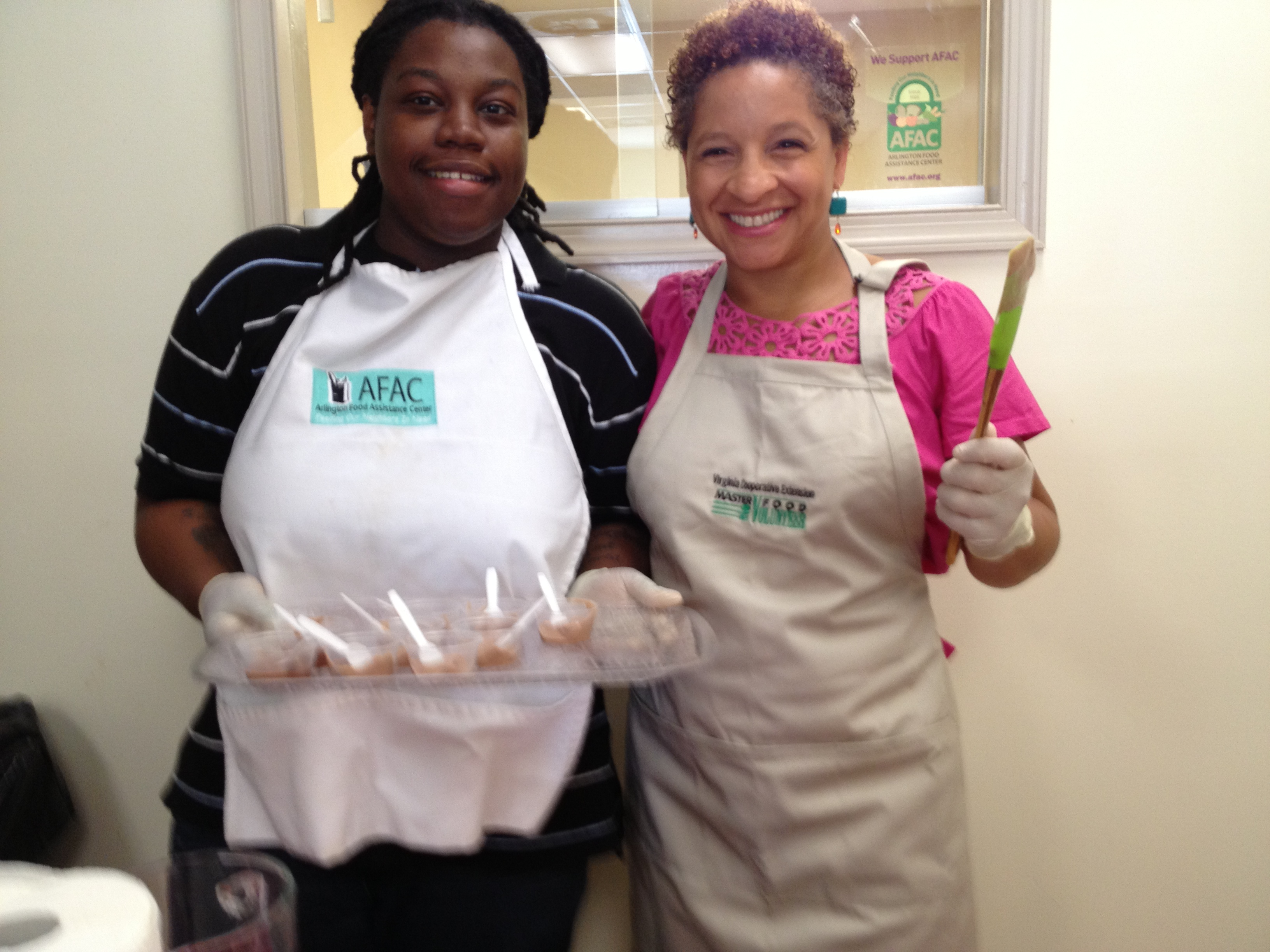 Kendra Ambrose and Catrina Moran pass out healthy sweet treats at AFAC in Arlington