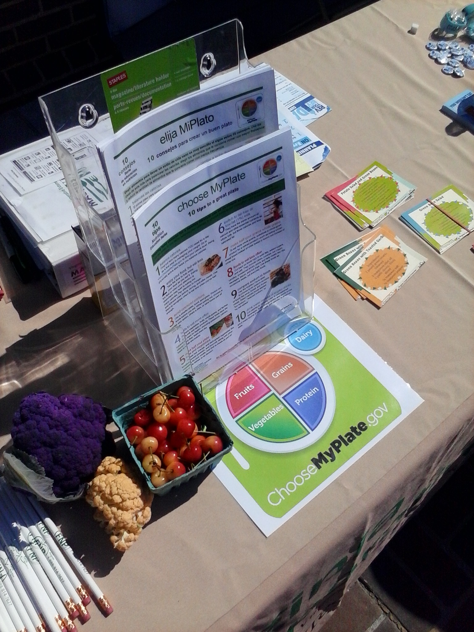 Volunteers shared information like these MyPlate flyers and recipe cards with market shoppers.