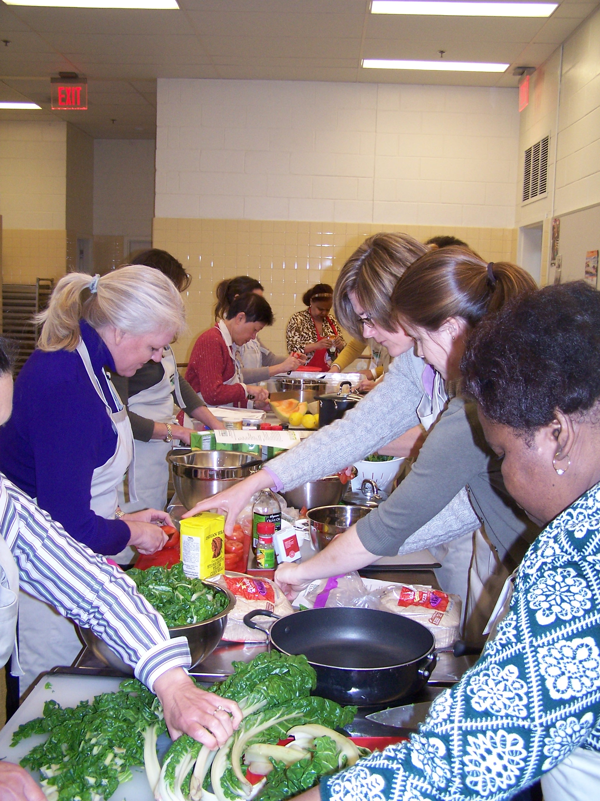 Participants in the 2013 training prepare a healthy lunch