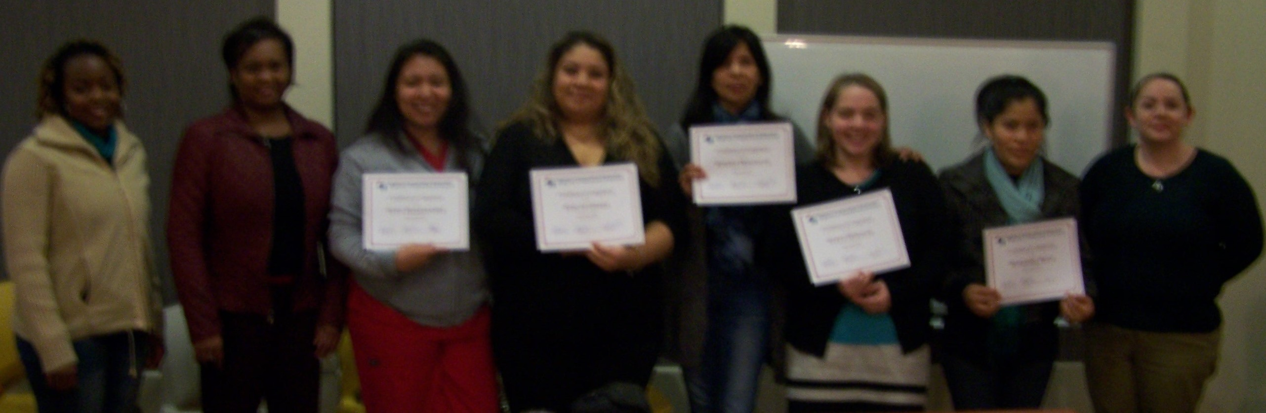 Participants pose with their certificates and coaches