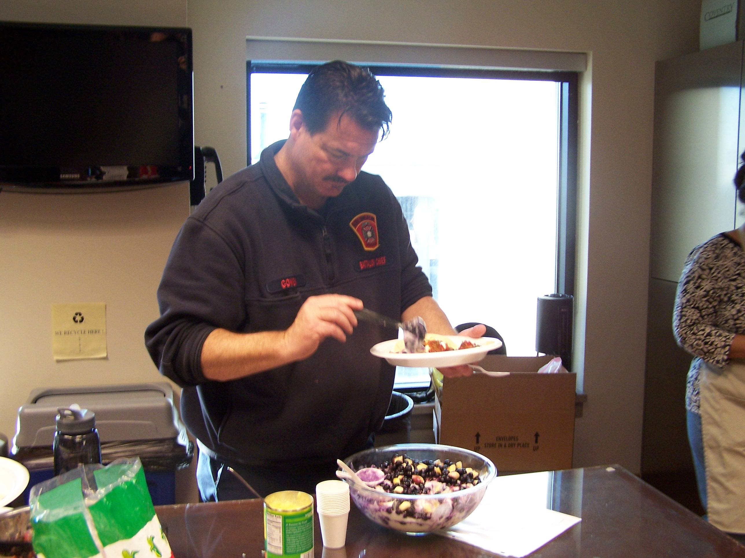A staff member serves up a portion of the breakfast parfait.