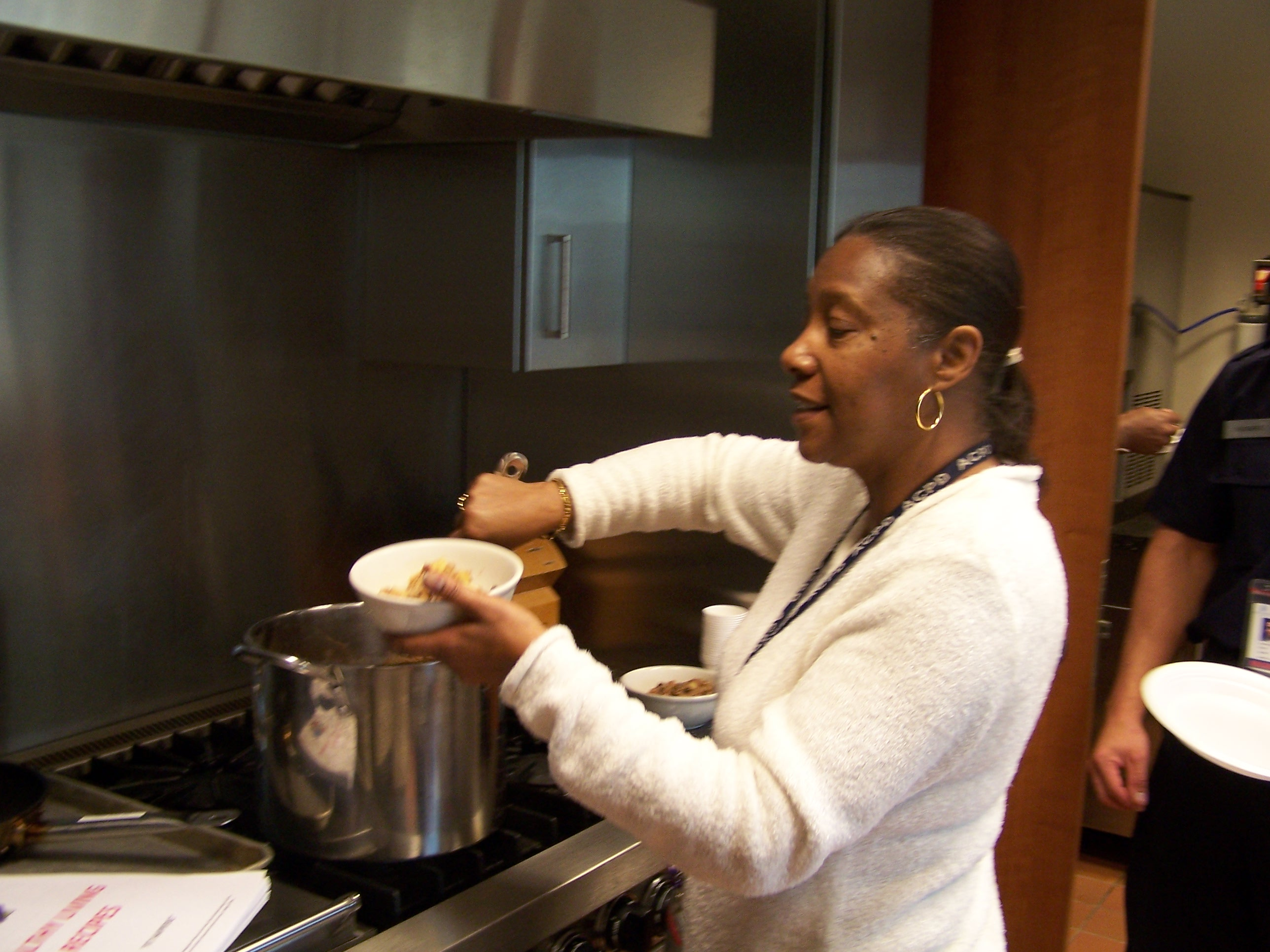 A staff member helps herself to Homemade Fruity Oatmeal.