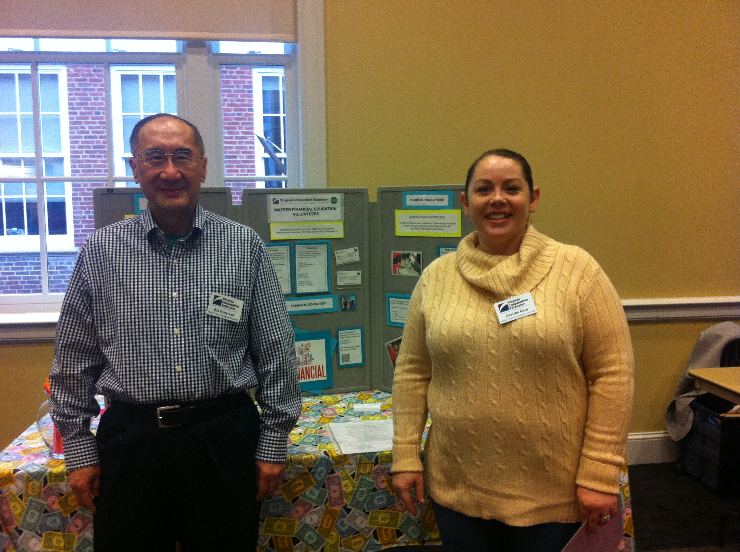 Volunteers Bill Guey-Lee and Desiree Kaul manage the Master Financial Education display.