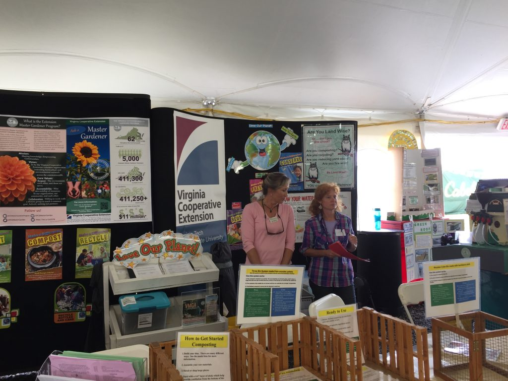 master  gardeners help attendees at state fair booth