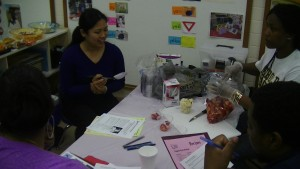Bowling Green State Univ. Dietetic Intern partners with Master Food Volunteer/Norfolk State University student and teach how to prepare the Family Nutrition Program recipe: Yogurt Fruit Parfait.