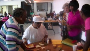 Master Food Volunteers assist with Choose My Plate for Seniors presentation at the Parks and Recreation Senior Station.